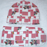 Baskets of Fruits on a red check  tea cosy and ovengloves