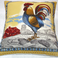 Cockerel on a farm at sunrise cushion