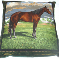 Chestnut Stallion standing in a field cushion