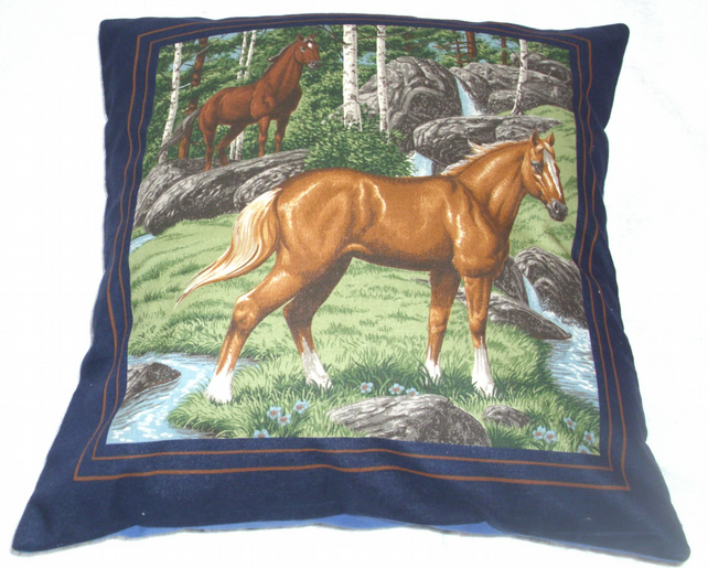 Two Wild horses by a stream beside a forest cushion