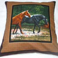 Two Wild horses walking through a stream cushion