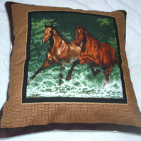 Two Wild horses galloping through a stream cushion