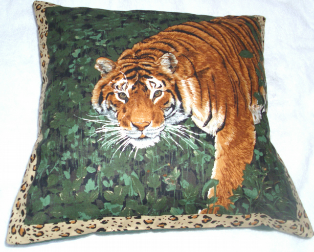 On Safari magnificent Tiger emerging from a forest cushion