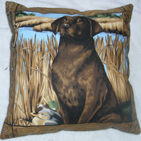 lovely Chocolate Labrador waiting for action cushion