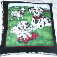 A Dalmation and young pups in the park cushion