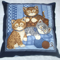 Three pretty Kitties playing with balls of wool cushion