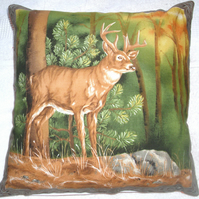 Stag standing in a clearing in an Autumnal forest cushion