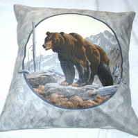 Brown Bear climbing up a mountain cushion