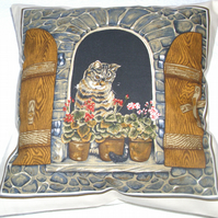 Lovely Grey Tabby cat sitting in window cushion