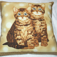 Two pretty Ginger Tabby  Kitties sitting together cushion