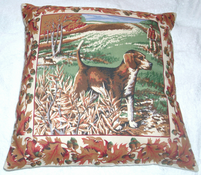 A Beagle waiting patiently in a field cushion