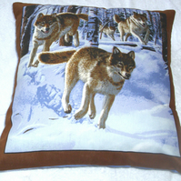 Pack of Wolves running through a Winter forest cushion