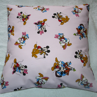 Mickey Mouse and Friends on a pink cushion