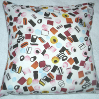 Liquorice Allsorts on white Cushion
