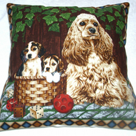 Dogs cushion with an American Cocker Spaniel  and pups in a garden.