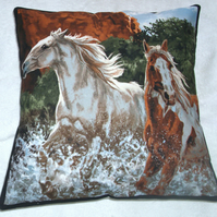 Two Wild horses galloping through a  river cushion