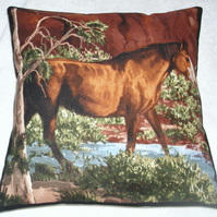 A beautiful chestnut brown and white horse stepping through a stream cushion