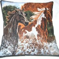 Two Wild horses  trotting through a  river cushion