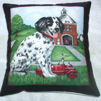 A Dalmation pup outside a fire station  cushion
