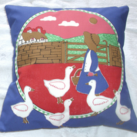Little Goosegirl with her geese cushion