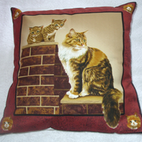 Lovely fluffy brown and white cat and kittens on a garden wall cushion