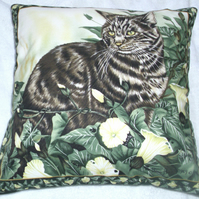 Beautiful tabby cat sitting among flowering ivy cushion