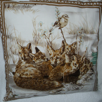 Vixen and her five cubs curled up in the snow Winter cushion