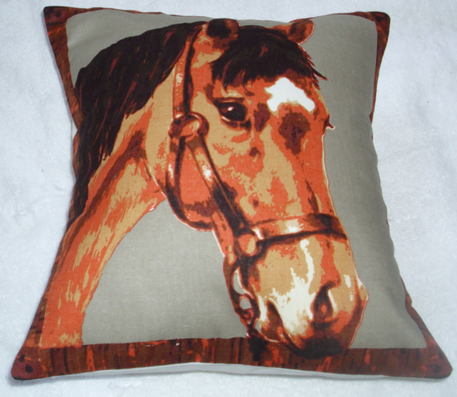 A beautiful brown horse looking over a stable door cushion