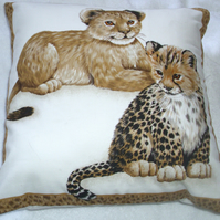 Adorable young Leopard cubs sitting waiting cushion