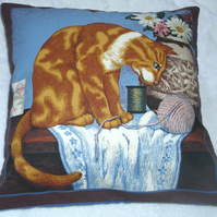 A lovely Ginger and white cat sitting with a vase of flowers cushion