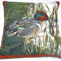 A Duck (Teal) standing by waters edge cushion