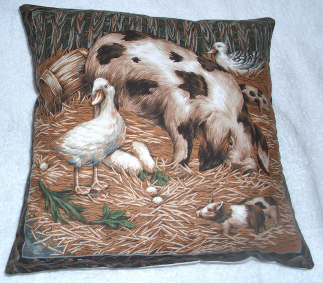 Sow and piglets in farmyard cushion