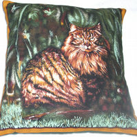 Lovely dark ginger and black fluffy Tabby cat sitting in a garden cushion