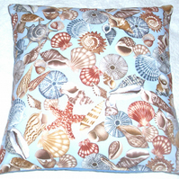 All sorts of Sea Shells on a blue cushion