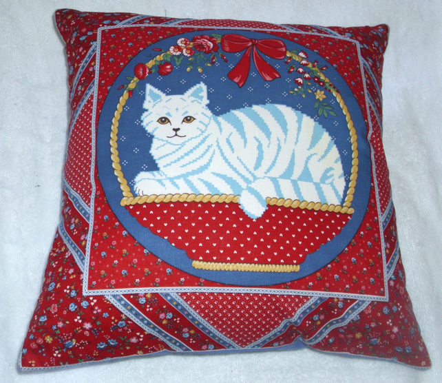 A lovely stylised blue tabby cat in a basket cushion