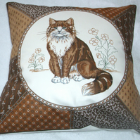 A very pretty brown and white fluffy cat cushion