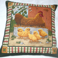 Chicken in crate with chicks in farmyard cushion