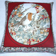 Pretty bright little Robin perched among Autumnal berries cushion