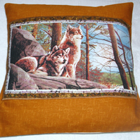 Wolves sitting up on a rocky ledge in Autumn cushion