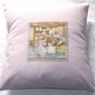 Beatrix Potter Mrs Tiggy Winkle in her cottage ironing with  Lucie cushion