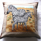 On Safari Zebra and young  standing on a  grassy plain cushion