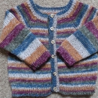Self-striping comfy cardigan for a baby boy