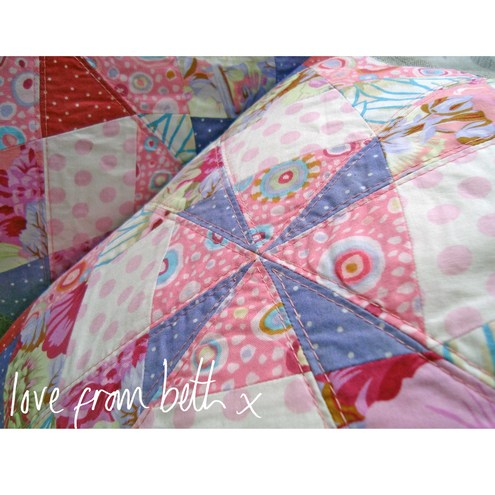 Pair of quilted patchwork cushion covers