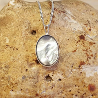 Small Black lip mother of pearl pendant. 14x10mm 925 sterling silver