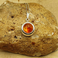 Small round amber pendant necklace. Simple minimalist jewellery. Reiki Charged.