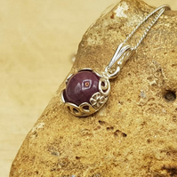 Tiny ruby pendant necklace. July birthstone