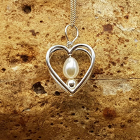 Fresh water pearl heart pendant necklace. June Birthstone