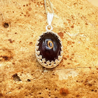 Small oval Garnet pendant. January Birthstone