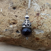 Small cone garnet pendant necklace. January birthstone