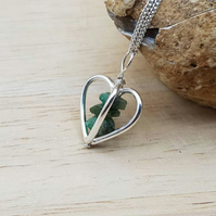 3D Heart Raw Emerald pendant necklace. May birthstone